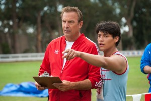 (l-r)  Coach Jim White (Kevin Costner) and Thomas Valles (Carlos Pratts) in MCFARLAND, USA. ©Disney Enterprises. CR: Ron Phillips.