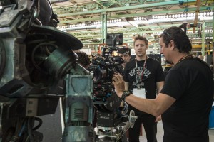 Director Neill Blomkamp (center) on the set of CHAPPIE. ©CTMG. CR: Stephanie Blomkamp.