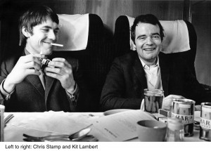 English Rock Band The Who. Going up to Manchester on the train.  Left is Chris Stamp (brother of Terence Stamp) who was the business manager.  and Kit Lambert Manager (producer on the album Tommy). 1966  Mandatory credit.  ©Colin Jones / TopFoto / The Image Works