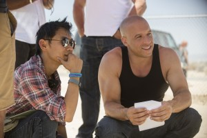 "(L to R) Director JAMES WAN and VIN DIESEL as Dom Toretto on the set of ""Furious 7"". ©Universal Pictures. CR: Jaimie Trueblood."