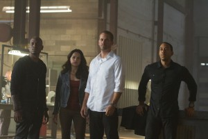 "(L to R) Roman (TYRESE GIBSON), Letty (MICHELLE RODRIGUEZ), Brian (PAUL WALKER) and Tej (CHRIS ""LUDACRIS"" BRIDGES) are back for ""Furious 7"". ©Univesal Studios. CR: Scott Garfield."