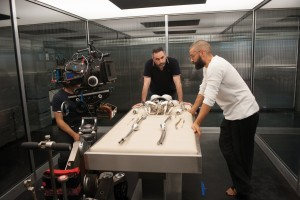 (l-r) Writer/director Alex Garland and Oscar Isaac on the set of EX-MACHINA. ©A24 Films.