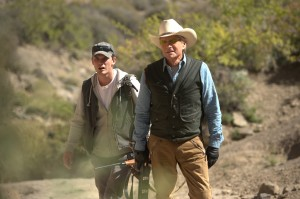 (l-r) Jeremy Irvine and Michael Douglas star in BEYOND THE REACH. ©Roadside Attractions. CR: Clay Enos.