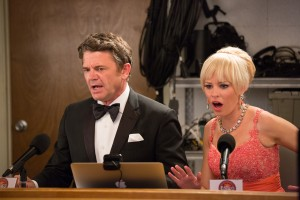 John (JOHN MICHAEL HIGGINS) and Gail (ELIZABETH BANKS) are shocked by the Barden Bellas' behavior in PITCH PERFECT 2. ©Universal Pictures. CR: Richard Chartwright.