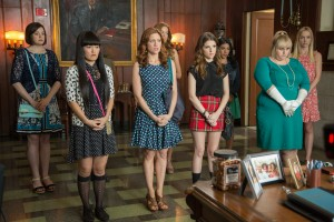 (L to R) Ashley (SHELLEY REGNER), Lilly (HANA MAE LEE), Chloe (BRITTANY SNOW), Stacie (ALEXIS KNAPP), Beca (ANNA KENDRICK), Flo (CHRISSIE FIT), Fat Amy (REBEL WILSON) and Jessica (KELLEY ALICE JAKLE) worry for the future of the Barden Bellas in PITCH PERFECT 2. ©Universal Pictures. CR: Richard Cartwright.
