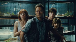 (L to R) Claire (BRYCE DALLAS HOWARD), Owen (CHRIS PRATT), Zach (NICK ROBINSON) and Gray (TY SIMPKINS) watch in terror in JURASSIC WORLD. ©Universal Studios/Amblin Entertainment.