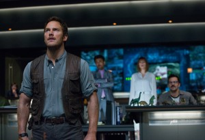 (L to R) Owen (CHRIS PRATT), Masrani (IRRFAN KHAN), Claire (BRYCE DALLAS HOWARD) and Lowery (JAKE JOHNSON) watch the monitors in horror in JURASSIC WORLD. ©Universal Studios/Amblin Entertainment. CR: Chuck Zlotnick.