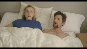 (l-r) Taylor Schilling and Adam Scott in THE OVERNIGHT. ©Sundance Institute.