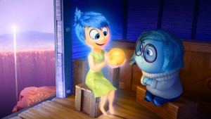 Joy (voice of Amy Poehler) and Sadness (voice of Phyllis Smith) catch a ride on the Train of Thought in Disney•Pixar's INSIDE OUT. Directed by Pete Docter and produced by Jonas Rivera. ©2Disney•Pixar.