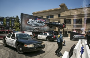 """Fast and Furious - Supercharged"" event features an airborne car smashing into a billboard. ©Universal Studios. CR: David Sprague."