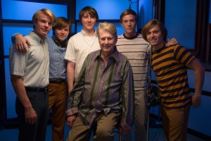 (l-r) Graham Rogers, Brett Davern, Paul Dano, Brian Wilson, Jake Abel and Kenny Wormald on the set of LOVE & MERCY. ©Roadside Attractions. CR: Francois Duhamel.