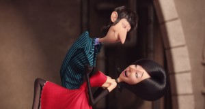 he world's first ever female super-villain, Scarlet Overkill (voiced by SANDRA BULLOCK) dances with husband Herb (JON HAMM) in MINIONS. ©Universal Studios.