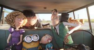 BOB (center) hitches a ride to Villain-Con from the Nelson family—(L to R) Madge (ALLISON JANNEY), Walter Jr. (MICHAEL BEATTIE), Binky, Walter (MICHAEL KEATON) and Tina (KATY MIXON) in MINIONS. ©Universal Studios.