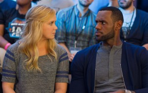 Amy (AMY SCHUMER) chats it up with LEBRON JAMES as himself in TRAINWRECK. ©Universal Studios. CR: Mary Cybulski.