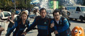 Violet (Michelle Monaghan), Sam Brenner (Adam Sandler), Ludlow (Josh Gad) and Q*bert in Columbia Pictures' PIXELS. ©CTMG. CR: Snny Pictures.