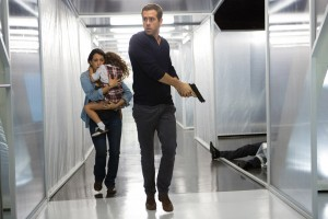 (l-r.) Madeline (Natalie Martinez) and daughter Anna (Jaynee-Lynne Kinchen) flee with Young Damian (Ryan Reynolds) in Gramercy Pictures' SELF/LESS. ©Gramercy Pictures. CR: Alan Markfield.