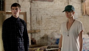 (l-r) Nicholas Hoult and Charlize Theron star in DARK PLACES. ©A24 Films. CR: Doane Gregory.