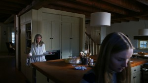 (L to R) Nana (DEANNA DUNAGAN) needs Becca's (OLIVIA DEJONGE) help cleaning the oven in Universal Pictures' THE VISIT. ©Universal Studios.