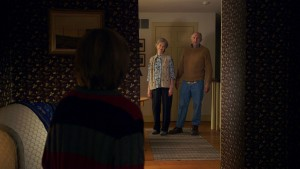(L to R) Tyler (ED OXENBOULD) is terrified by Nana (DEANNA DUNAGAN) and Pop Pop (PETER MCROBBIE) in THE VISIT. ©Universal Studios.