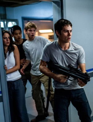 Thomas (Dylan O'Brien, right) leads Teresa (Kaya Scodelario), Minho (Ki Hong Lee), and Newt (Thomas Brodie-Sangster) in a daring escape from WCKD in MAZE RUNNER: THE SCORCH TRIALS. ©20th Century Fox. CR: Richard Foreman, Jr. SMPSP.