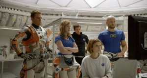 (from left) Matt Damon, Jessica Chastain, Sebastian Stan, Kate Mara, and Aksel Hennie portray the crewmembers of the fateful mission to Mars in THE MARTIAN. ©20th Century Fox.