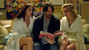 (l-r) Lorenza Izzo (Genesis), Keanu Reeves (Evan) and Ana De Armas (Bel) star in KNOCK KNOCK. ©Lionsgate Entertainment.
