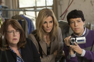(l-r) Ann Dowd as Nell, Sandra Bullock as Jane Bodine and Reynaldo Pacheco as Eddie in OUR BRAND IS CRISIS. ©Warner Bros. Enertainment/Ratpac-Dune Entertainment. CR: Patti Perret.
