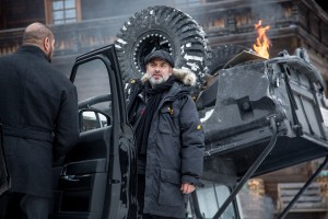 Sam Mendes (Director) and Dave Bautista (Hinx) discussing the scene by the crashed Range Rover between takes; Obertilliach, Austria on the set of Metro-Goldwyn-Mayer Pictures/Columbia Pictures/EON Productions' action adventure SPECTRE. ©MGM Studios, Danjaq LLC and Columbia Pictures. CR: Jonathan Olley.