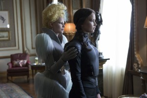 Effie Trinket (Elizabeth Banks, left) and Katniss Everdeen (Jennifer Lawrence, right) in THE HUNGER GAMES: MOCKINGJAY – PART 2. ©Lionsgate Entertainment. CR: Murray Close.