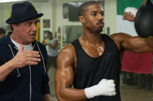 (l-r) Sylvester Stallone as Rocky Balboa and Michael B. Jordan as Adonis Creed in CREED. ©Warner Bros. Entertainment/MGM Pictures. CR: Barry Wetcher.