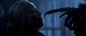 Omi (KRISTA STADLER) encounters the wrath of Krampus in Legendary Pictures' KRAMPUS. ©Legendary Pictures/Universal Studios.