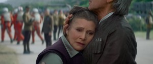 (l-r)  Leia (Carrie Fisher) and Han Solo (Harrison Ford) embrace in STAR WARS: THE FORCE AWAKENS. ©Lucasfilm Ltd. & TM. All Right Reserved.