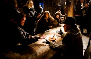(L-R) QUENTIN TARANTINO directs KURT RUSSELL, JENNIFER JASON LEIGH, and TIM ROTH on the set of THE HATEFUL EIGHT. ©The Weinstein Company. CR: Andrew Cooper.