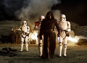 Kylo Ren (Adam Driver) with Stormtroopers in STAR WARS: THE FORCE AWAKENS. ©Lucasfilms. CR: David James.