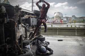 Deadpool (Ryan Reynolds) pounces on an adversary in DEADPOOL. ©20th Century Fox / Marvel. CR: Joe Lederer.