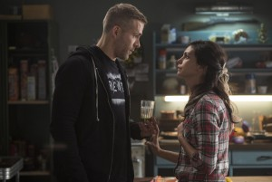 Wade Wilson (Ryan Reyonlds) and new squeeze Vanessa (Morena Baccarin) trade some pointed barbs, in DEADPOOL ©20th Century Fox / Marvel. CR: Joe Lederer.