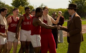(l-r) Stephan James (center) stars as Jesse Owens and Jason Sudeikis (right) stars as Larry Snyder in Stephen Hopkins' RACE, ©Focus Features. CR: Thibault Grabherr.