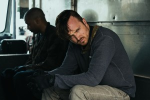 (l-r) Chiwetel Ejiofo and Aaron Paul star in TRIPLE 9. ©Open Road Films. CR: Bob Mahoney.