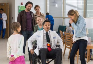 Dr. Nurko (EUGENIO DERBEZ) rides in the wheel chair as Anna (KYLIE ROGERS) pushes while Kevin (MARTIN HENDERSON), Christy (JENNIFER GARNER), Abbie (BRIGHTON SHARBINO) and Adelynn (COURTNEY FANSLER) watch in Columbia Pictures' MIRACLES FROM HEAVEN. ©CTMG. CR: Chuck Zlotnick.