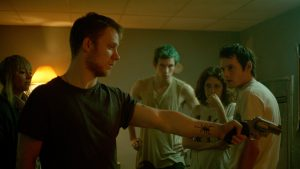 (l-r) Imogen Poots, Joe Cole, Callum Turner, Alia Shawkat and Anton Yelchin star in Jeremy Saulnier's GREEN ROOM. ©A24. CR: Scott Patrick Green.