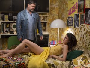 (l-r) Russell Crowe as Jackson Healy and Margaret Qualley as Amelia in THE NICE GUYS. ©Warner Bros. Entertainment. CR: Daniel McFadden.