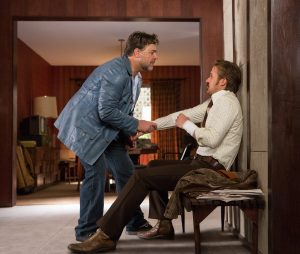 (l-r) Russell Crowe as Jackson Healy and Ryan Gosling as Holland March in THE NICE GUYS. ©Warner Bros. Entertainment. CR: Daniel McFadden.