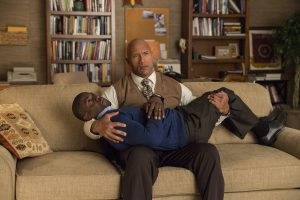 Bob Magnum (Dwayne Johnson) cradles Calvin Joyner (Kevin Hart) in CENTRAL INTELLIGENCE. ©Warner Bros. Entertainment. CR: Claire Folger.