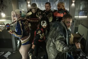 (L-r) MARGOT ROBBIE as Harley Quinn, ADEWALE AKINNUOYE-AGBAJE as Killer Croc, KAREN FUKUHARA as Katana, JOEL KINNAMAN as Rick Flagg and JAI COURTNEY as Boo in SUICIDE SQUAD. ©Warner Bros. Entertainment/Ratpac-Dune Entertainment LLC. CR: Clay Enos.