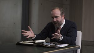 "A psychologist (Paul Giamatti) conducts an unusual interview as part of an investigation of a ""human"" whose actions present a mystery of both infinite promise and incalculable danger in Luke Scott's MORGAN. ©20th Century Fox. CR: Aidan Monaghan."