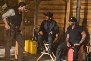 Chris Pratt, Denzel Washington and Director Antoine Fuqua on the set of Metro-Goldwyn-Mayer Pictures and Columbia Pictures' THE MAGNIFICENT SEVEN. ©MGM / Columbia Pictures. CR: Sam Emerson.