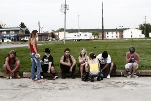 (l-r) McCaul Lombardi, Riley Keough, Verronikah Ezell, Shia LaBeouf, Crystal B. Ice, Shawna Rae Moseley, Kenneth Kory Tucker and Raymond Coalson star in Andrea Arnold's AMERICAN HONEY. ©A24. CR: Holly Horner.