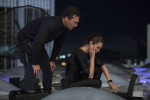 """The """"Joneses"""" (Gal Gadot, Jon Hamm) engage in some masterful spy craft in KEEPING UP WITH THE JONESES. ©20th Century Fox. CR: Frank Masi, SMPSP."""