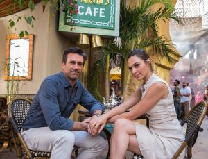 "Jon Hamm and Gal Gadot portray the ""Joneses,"" covert operatives posing as a suburban couple in KEEPING UP WITH THE JONESES ©20th Century Fox. CR: Frank Masi, SMPSP."