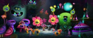 "Poppy's (center left with guitar, voiced by Anna Kendrock) rendition of ""The Sounds of Silence"" reaches its climax as a grumpy Branch (center right, voiced by Justin Timberlake) looks on in DreamWorks Animation's TROLLS. ©DreamWorks Animation."